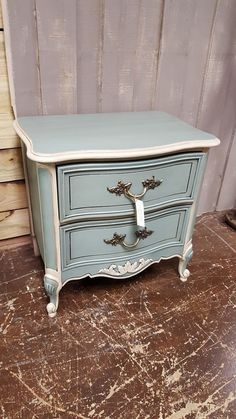 The Crooked Twig at Funky Monkey Vintage Market painted this Vintage French provincial nightstand/side table in Dixie Belle Paint Company Vintage Duck Egg