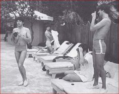 The Beatles swimming and taking photos