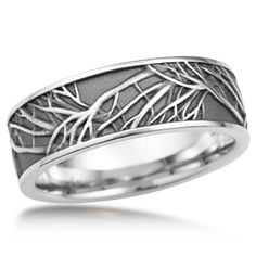 This is the matching men's wedding band to the Tree of Life Engagement Ring. A similar branch pattern repeats and overlaps around this ring. The recesses can be darkened to create contrast between the tree and background.