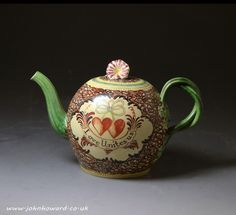 Antique creamware English pottery chintz pattern teapot. 5 inches high C.1775