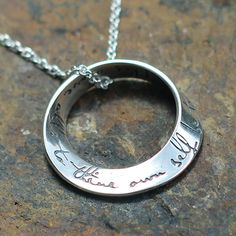 """Sterling silver möbius necklace, engraved with the words """"This above all: to thine own self be true."""" These words of advice, given by Polonius to his son Laertes in Shakespeare's Hamlet, are timeless in their wisdom. Commonly understood as a call for loyalty to your dreams and inner compass, it was also originally meant as a warning to take care of oneself first, so you can be of help to others. Like an oxygen mask in an airplane, you must fill your own lungs before you can give breath to…"""