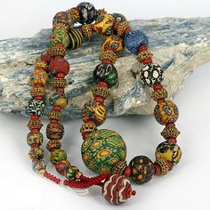 by SKJ ancient bead art   Necklace made up of an exquisite collection of ancient mosaic glass beads with gold granulation beads. Islamic world. Gold is 18k & from Rajasthan.  Beads collected mostly from Pakistan and surrounds   Price on Request