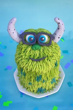 My sons first birthday monster cake for a cake smash! I love how he turned out! :) He is a 4 layer 4 inch cake.