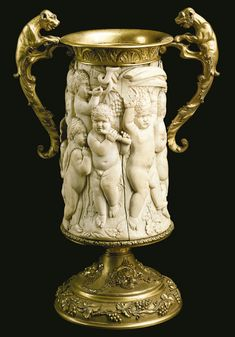 A gilt bronze mounted carved ivory tankard Continental, 19th century.