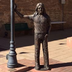 Well come on baby, Don't say maybe, i gotta know if your sweet love, is gonna save me. New Glenn Frey statue in Winslow, 9/2016