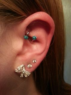 Sprial rook earring, and lobe piercings Rook Piercing Jewelry, Piercing Orbital, Rook Jewelry, Triple Piercing, Jewellery, Chain Earrings, Crystal Earrings, Diamond Earrings, Barbell Industrial