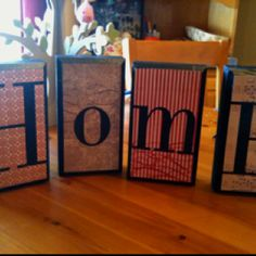 Wooden blocks, scrapbook paper and vinyl letters!!  (going to do this but with wooden letters)
