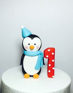 Penguin cake topper. Fondant penguin winter onederland cake topper. Penguin baby with party hat and