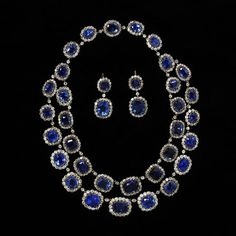 Necklace and Earrings, sapphires in brilliant-cut diamond borders, open-set in silver, England, about 1850. The necklace was adapted in the 1930s from a single row necklace to a double row, probably for Lady Cory; the accompanying earrings possibly made from parts of the necklace. Necklace: Height: 21 cm, Width: 20.5 cm, Depth: 1.2 cm, Earrings: Height: 5.3 cm, Width: 2.1 cm, Depth: 1.6 cm. http://collections.vam.ac.uk/item/O114990/earrings-unknown/