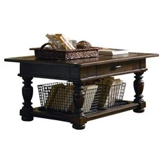 This rustic coffee table offers charming appeal with a plank-style top and turned legs, while its 1 drawer and 2 baskets stow magazines, throws, and remotes....