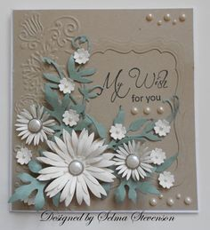 card with posies galore...like how the bright white stands out against the neutral tan and green of the card...lovely!!!
