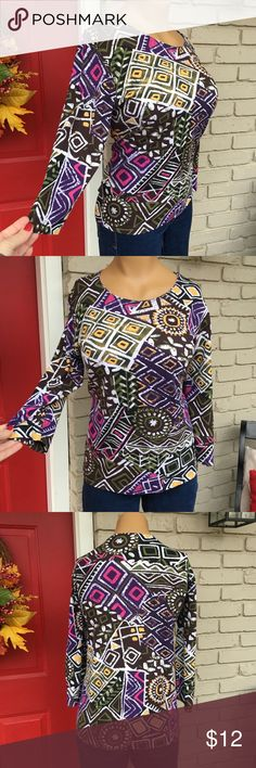 Beautifully colored and patterned geometric top 3/4 sleeve colorful geometric fitted top- looks great with denim, white, or black pants. Also looks great and wears well under jackets! Rebecca Malone Tops