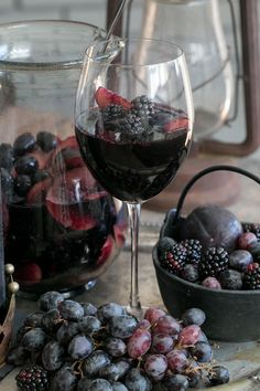 Black Sangria 1 bottle Apothic Dark 2 cups organic blackberries, washed 4 black plums, washed and sliced 2 cups black grapes, washed 1 cup sparkling water if you desire, but you don't have to if you want a strong wine taste.  Directions: Add everything into a pitcher and mix with a large spoon. Let it sit in the refrigerator for 1 to 2 hours. The longer it sits the darker the plums becomes. Best to keep sangria in the fridge. Enjoy!!!
