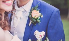 Couple: Bride and Groom, Navy suit, hearts, wedding photos, peach and lavender button hole. Photos By: www.ryanandsaraphotography.co.uk/