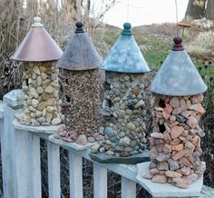 Ok, so I love this idea, I have tons of pretty rocks I collect from our cabin up North, so I am going to buy a basic wood or tin birdhouse and attempt to hot glue the rocks on, I also want to attempt a rock birdbath...we shalll see :)