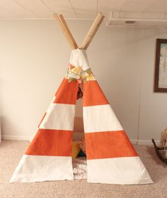 Create a fun play place for your children. Make your own DIY tee pee. #teepee #kids #diy