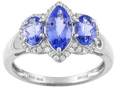 This blue! How great would this look with cobalt blue shoes?? | 1.66ctw Marquise And Oval Blue Tanzanite With .26ctw Round White Zircon 10k White Gold Ring