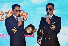 Hong Kong actors Louis Koo (R) and Julian Cheung speak during a press conference for their new movie 'Triumph in the Skies' in Beijing, China, September 22, 2014