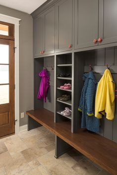 entryway ideas Farmhouse Entry Designs Minneapolis coat storage country country home farm house farmhouse grey cabinets mudroom Porch red hooks red knobs shoe storage wood bench