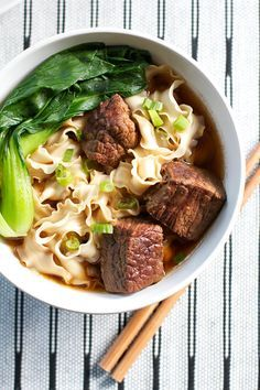 "TAIWANESE BEEF NOODLE SOUP - ""Taiwanese beef noodle soup is called hong shao niu rou mian. Beef shank or brisket are traditionally used, but a nice marbled beef chuck would work as well. The beef becomes so tender in this dish, and the broth is full of intense flavor (thanks to the anise seed!) when simmered for up to 3 hours. It is worth the wait."""