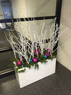 Holiday planter with flocked branches, greens & holiday balls