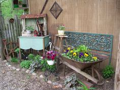 Love this display of old stuff and flowers by the shed