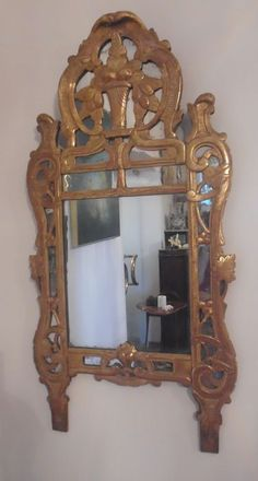 A Louis XV mirror in carved and gilded wood - France - 18th century