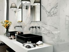 True marble is beautiful but can be problematic in the bathroom. It's prone to staining and very expensive. This porcelain tile mimics the intricate veins of marble.