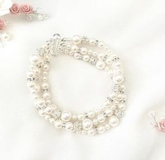 The perfect mix of pearls and rhinestones, this swarovski bridal bracelet with 3 strands is a lovely compliment to any bridal style!  by Ali Christine Bridal @ www.alichristinebridal.com