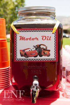 Events Not Forgotten: Cars Themed Birthday Party -- First Anti-Freeze, now Motor Oil....do we really want to serve this at a kids party? young kids have imagination - what if they find motor oil and ingest it...hey it looked just like the kind at little Timmy's party, it was just in a different container, and it smelled funny, but what the hey...