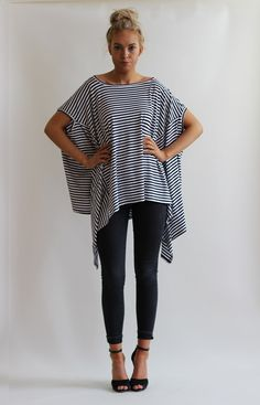 Oversized layering top in striped fabric. Drapes from the bust creating a waterfall effect.