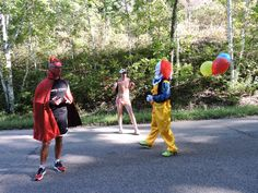 Unlikely combinations are the norm on the hills of the Ironman Wisconsin bike course. Dean meets new friends Drag Suit Boy and Ooky Clown.