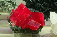 Rhodochrosite on matrix. By mineral-forum.com