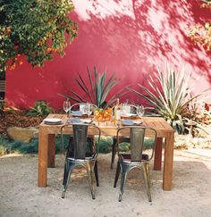 Red wall in an outdoor dining patio