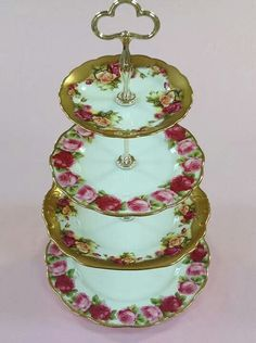 Roses and gold china cake tier, via Helen's Royal Tea House