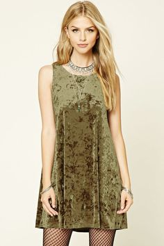 Style Deals - A swing dress crafted from crushed velvet and featuring a sleeveless cut and a round neckline.