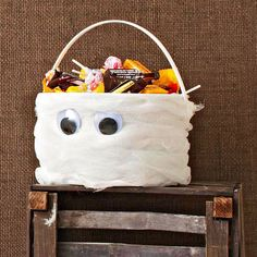 Mummify your candy bowl with our easy DIY: http://www.bhg.com/halloween/recipes/quick-halloween-party-food/?socsrc=bhgpin092014mummifiedcandybowl&page=10