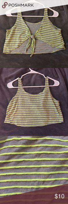 Crop top with tie in back Super cute crop top that ties in back.  Loose fitting on me. Worn only once or twice so in nearly perfect condition. Forever 21 Tops Crop Tops