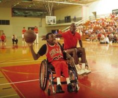 Michael Jordan plays wheelchair basketball during a hoops camp in July, 1987.