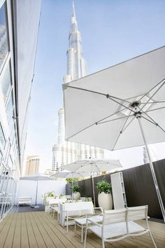 UPM ProFi Deck in Stone Grey and Sunny Beige in a restaurant at the feet of Burj Khalifa skyscraper in Dubai, UAE. Wpc Decking, Composite Decking, Plastic Wood Decking, Grey Stone, Walkway, Skyscraper, Patio, Flooring, Outdoor Decor