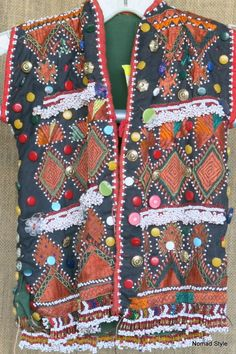 Vintage, multi-colored hand embroidered child's vest from Southern Afghanistan.  [$379.00]