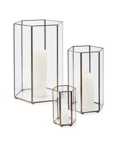 The beauty of this six-sided glass hurricane is in the glow--multiple panels bounce light for an almost mirror-like effect. The brass-faceted details add delicate jewel-like beauty and dimension. Place strategically throughout the house or create a centerpiece with a mix of sizes for the ultimate in dining drama.