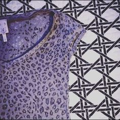Leopard Print Tee Super cute leopard print tee features v-neckline! PLEASE NO TRADES ✔Reasonable offers accepted✔️ Please inquire!! Rue 21 Tops Tees - Short Sleeve