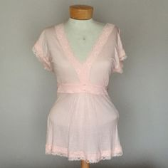 "🆕 Express Light Pink top. Size Large 🆕 Express Light Pink top. Size Large. 26"" long. Ties in back. Poly and spandex Express Tops Blouses"
