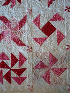 Pinwheel sampler at Mainely Quilts of Love: longarm quilting--I adore these quilting designs! If only I'd seen this before quilting my pinwheel quilt!