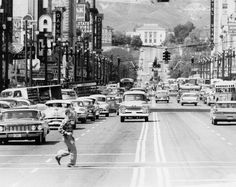 A man crosses Salt Lake City's Main Street in 1960.