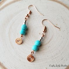 Turquoise dyed howlite and copper swirl drop earrings