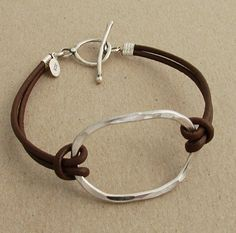 sterling oval on leather bracelet by j