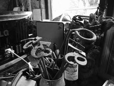 black and white photo of very old branding equipment