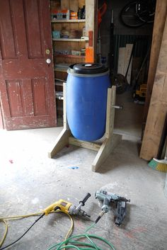 DIY Compost Tumbler Tutorial: Supplies - recycled food-grade bins One of 6 Timberlok screws deck screws Two T-shaped brackets Six lags galvanized pipe Two galvanized pipe caps Pressure treated wood: One One One